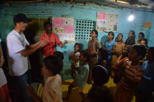 Enthusiastic students in the tiny classroom in the slums