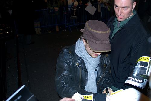 Daniel Radcliffe signing autographs on Broadway.  Photocredit:  Laura Bittner (Flickr user wolfsavard)