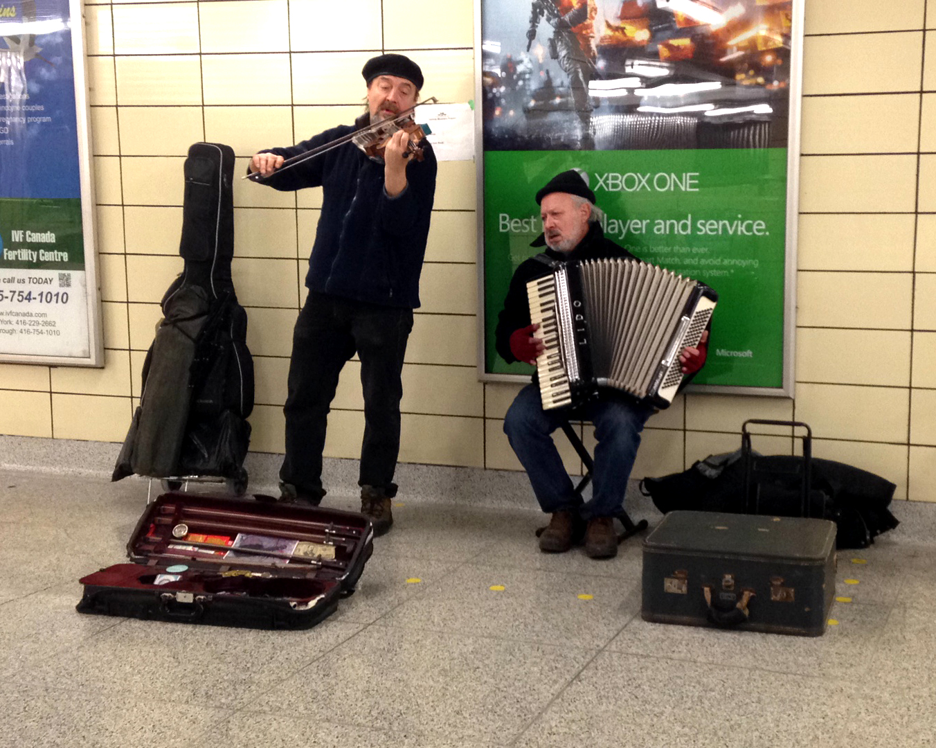 Andrei and Andre playing Violin and Accordian in the subway station