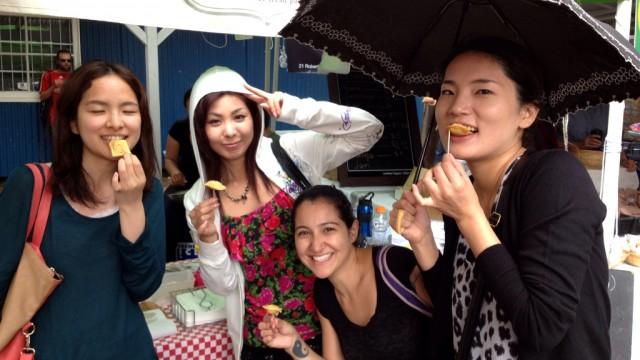 Enjoying some treats at the market
