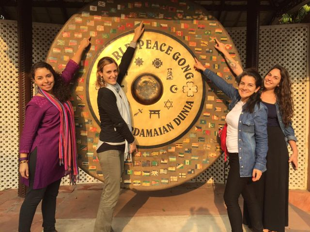 Students standing near the World Peace Gong at New Delhi